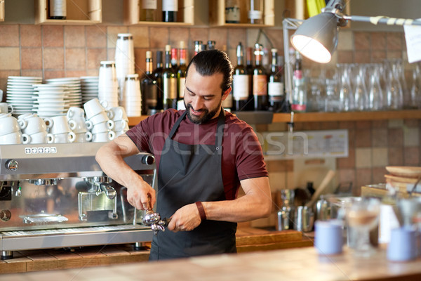 barista with holder and tamper making at coffee Stock photo © dolgachov