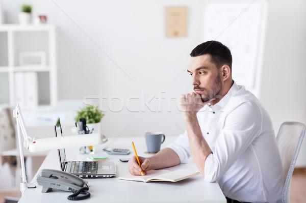 üzletember laptop notebook iroda üzletemberek ül Stock fotó © dolgachov