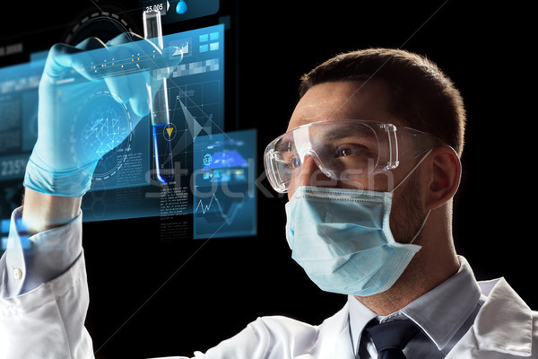 scientist with test tube and virtual screen Stock photo © dolgachov