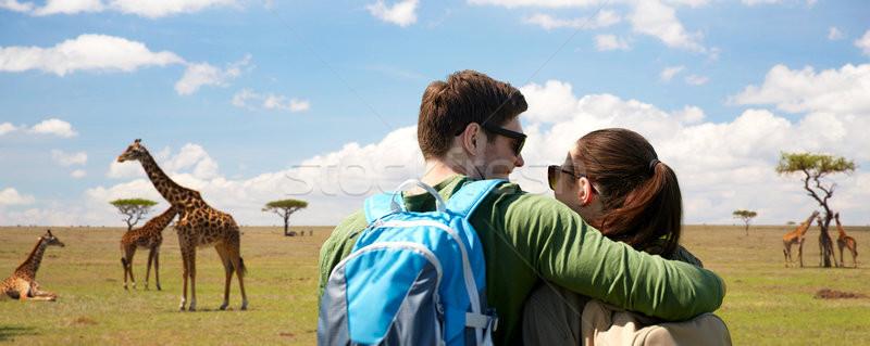 happy couple with backpacks traveling Stock photo © dolgachov