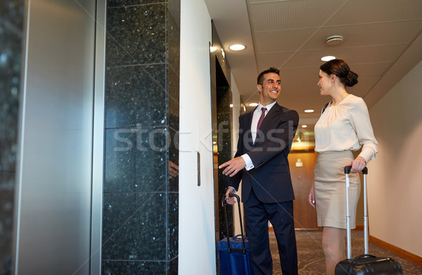 business team with travel bags at hotel elevator Stock photo © dolgachov