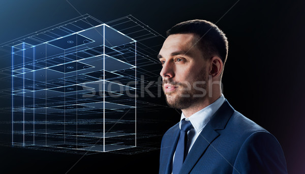 businessman in suit with virtual building hologram Stock photo © dolgachov
