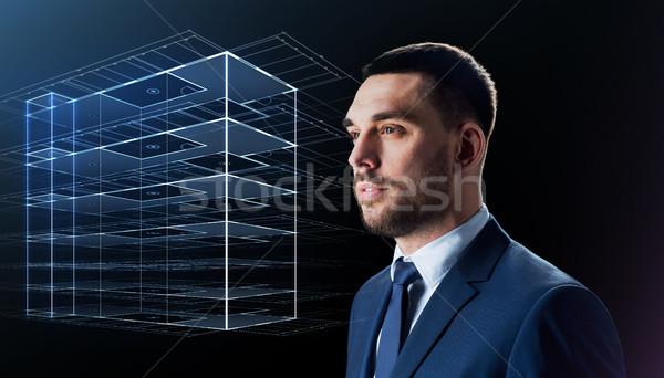 üzletember öltöny virtuális épület hologram üzletemberek Stock fotó © dolgachov