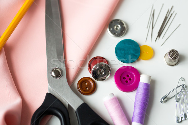 scissors, sewing tools and cloth Stock photo © dolgachov