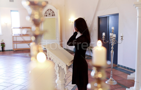 woman with wipe crying at funeral in church Stock photo © dolgachov