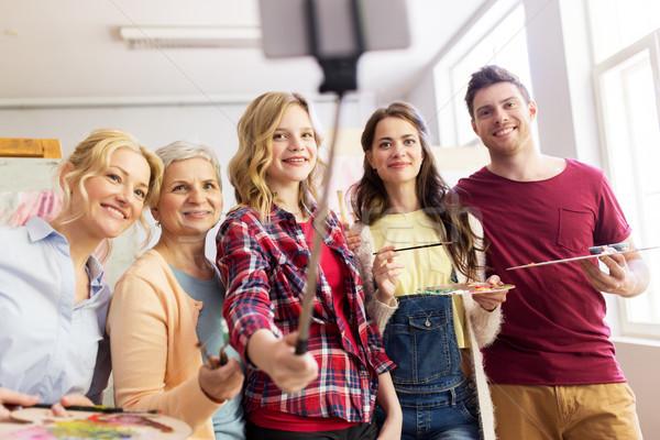 group of artists taking selfie at art school Stock photo © dolgachov