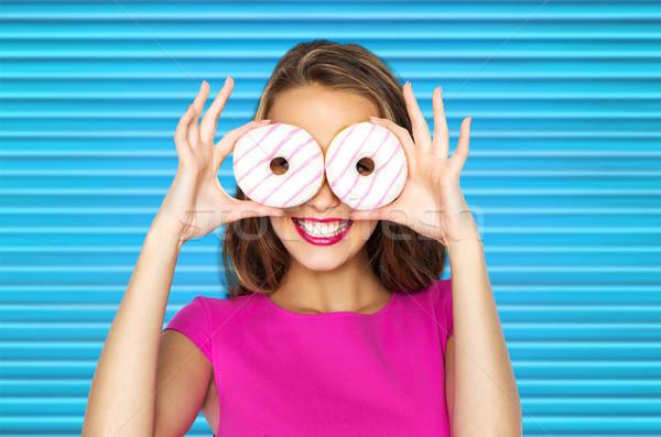 happy woman or teen girl looking through donuts Stock photo © dolgachov