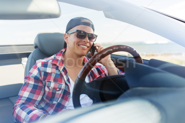 happy man calling on smartphone in convertible car Stock photo © dolgachov