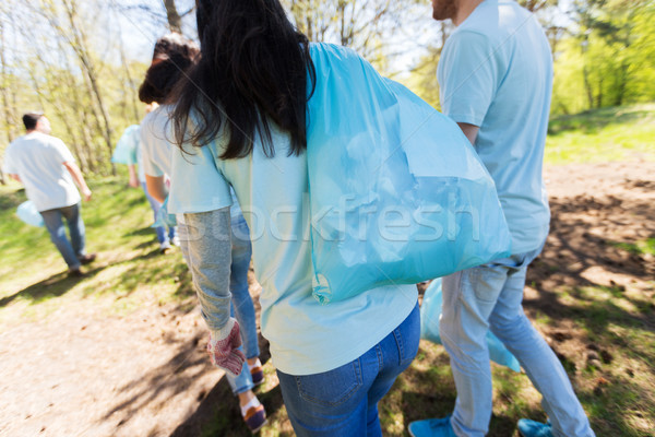 group of volunteers with garbage bags in park Stock photo © dolgachov