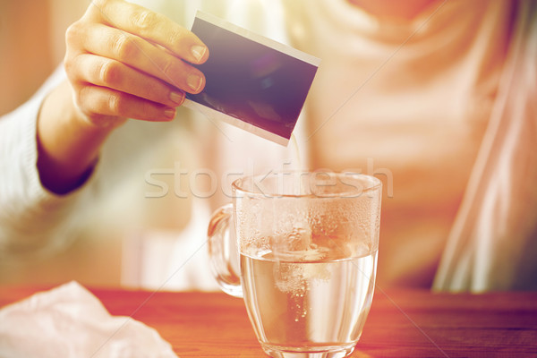 woman pouring medication into cup of water Stock photo © dolgachov