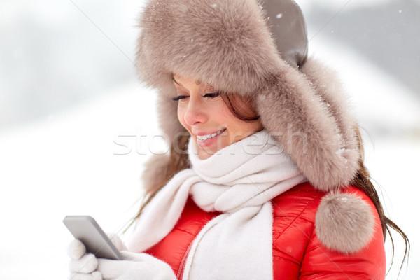 幸せ 女性 冬 毛皮 帽子 スマートフォン ストックフォト © dolgachov