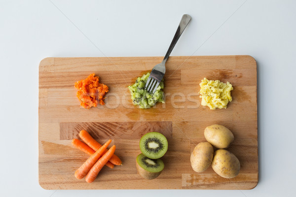 mashed fruits and vegetables with forks on board Stock photo © dolgachov