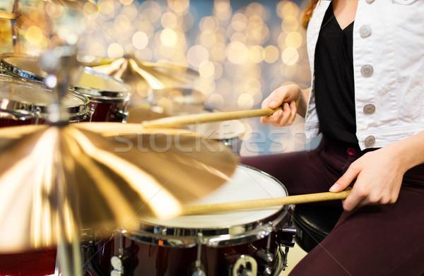 close up of woman drummer playing drum kit Stock photo © dolgachov