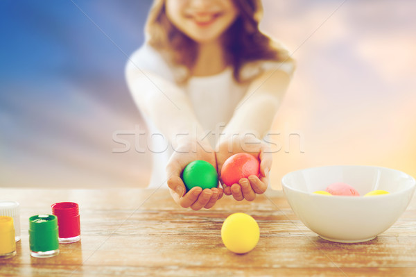 close up of girl holding colored easter eggs Stock photo © dolgachov