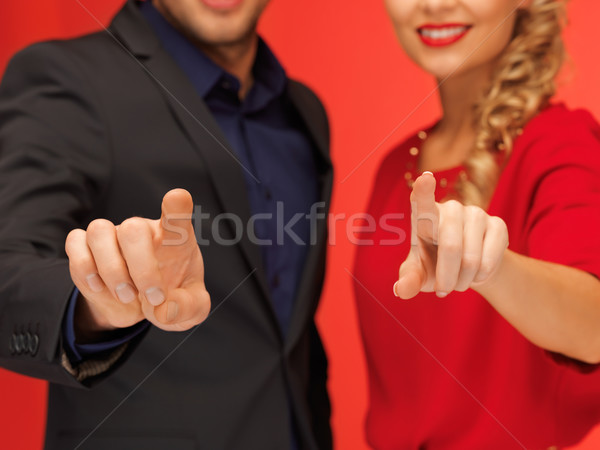 man and woman pressing virtual button Stock photo © dolgachov