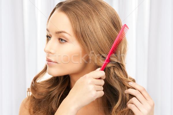 Gyönyörű nő fésű fényes kép nő arc Stock fotó © dolgachov