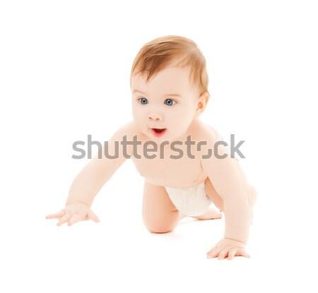 Kúszás kíváncsi baba fényes közelkép kép Stock fotó © dolgachov