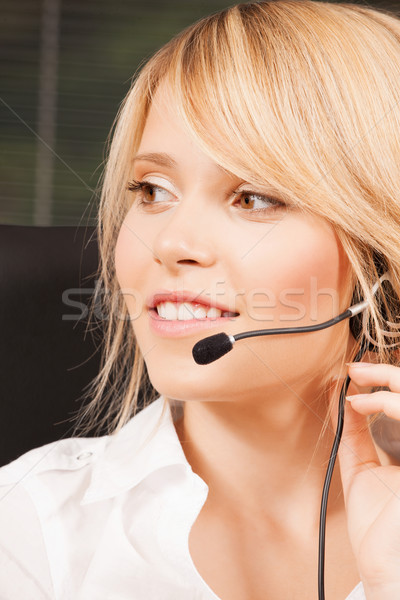 female helpline operator with headphones Stock photo © dolgachov