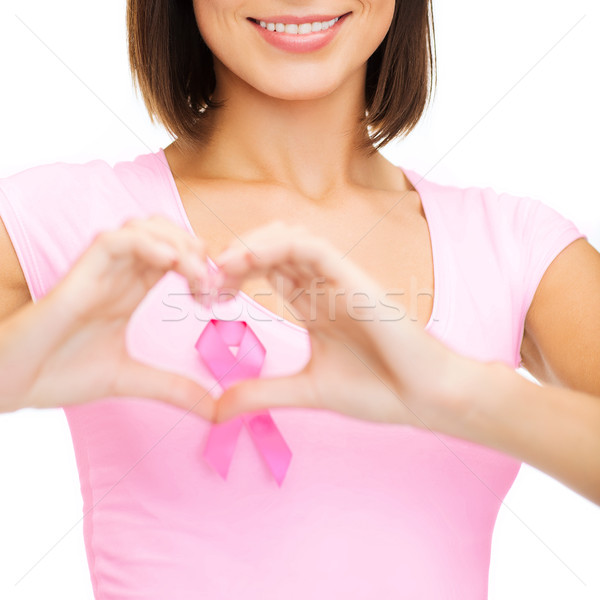 woman with pink cancer ribbon Stock photo © dolgachov