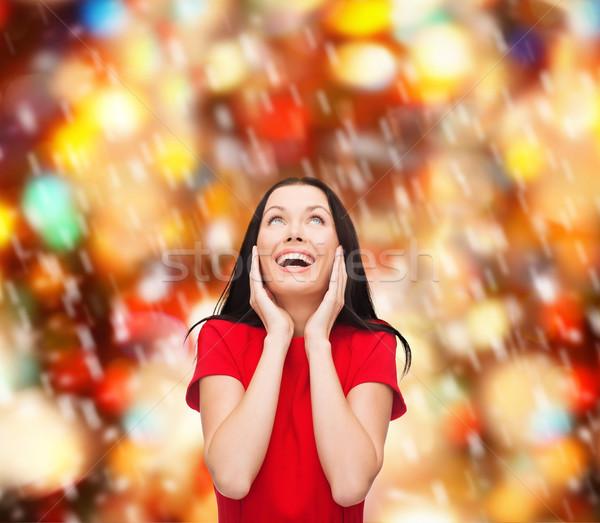 Verwonderd lachend jonge vrouw rode jurk geluk mensen Stockfoto © dolgachov
