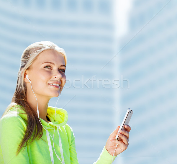 woman listening to music outdoors Stock photo © dolgachov