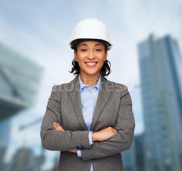 businesswoman in white helmet with crossed arms Stock photo © dolgachov