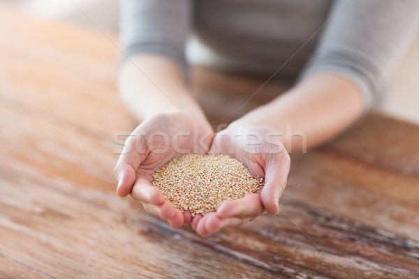 cloes uo of female cupped hands with quinoa Stock photo © dolgachov