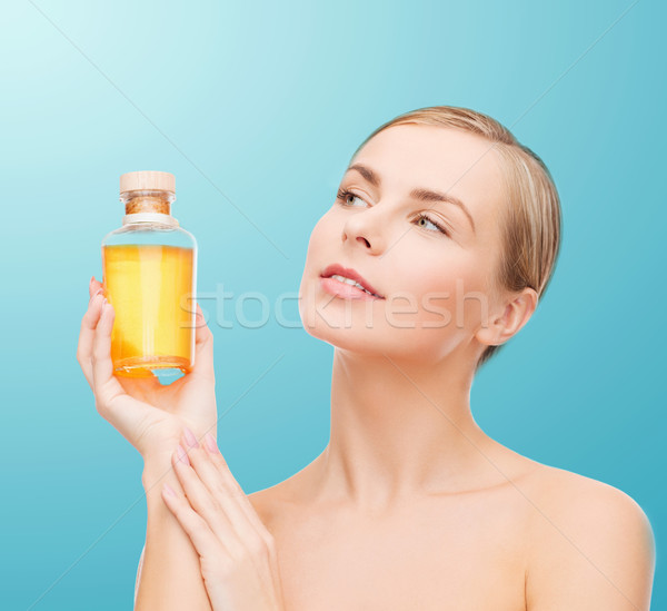lovely woman with oil bottle Stock photo © dolgachov