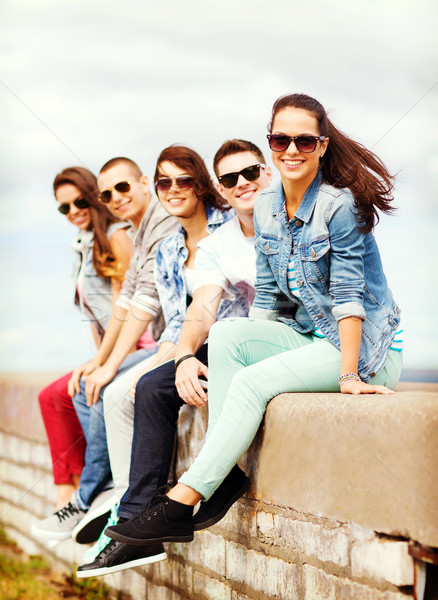 group of teenagers hanging out Stock photo © dolgachov