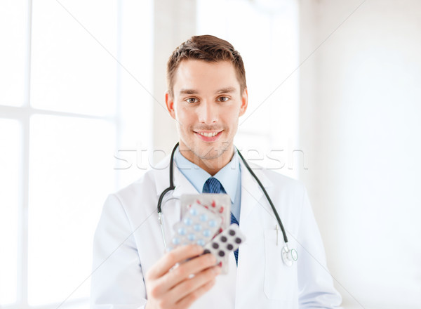 smiling male doctor with pills in hospital Stock photo © dolgachov