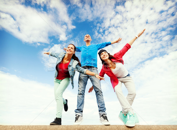 group of teenagers spreading hands Stock photo © dolgachov