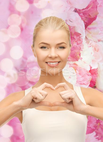 Sonriendo forma de corazón gesto amor Foto stock © dolgachov