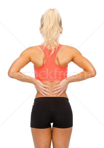 sporty woman touching her back Stock photo © dolgachov