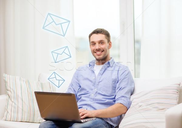 Sorridere uomo lavoro laptop home business Foto d'archivio © dolgachov