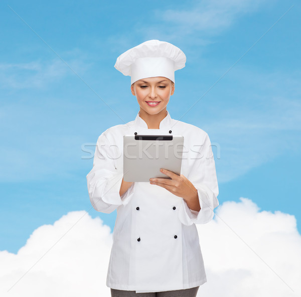 smiling female chef with tablet pc computer Stock photo © dolgachov