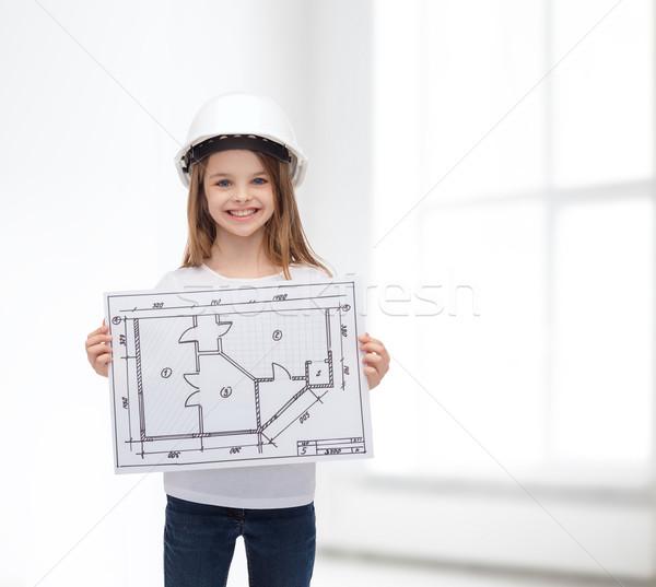 Glimlachend meisje helm tonen blauwdruk gebouw Stockfoto © dolgachov