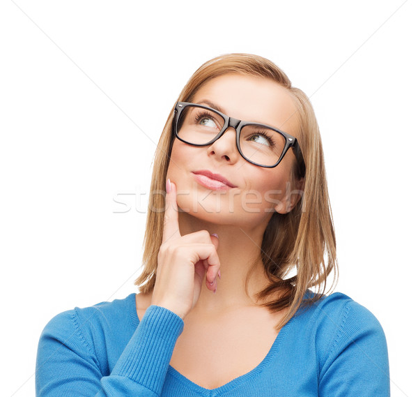 Stock photo: happy woman in black eyeglasses dreaming