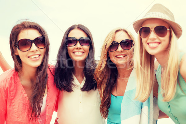 girls in shades having fun on the beach Stock photo © dolgachov