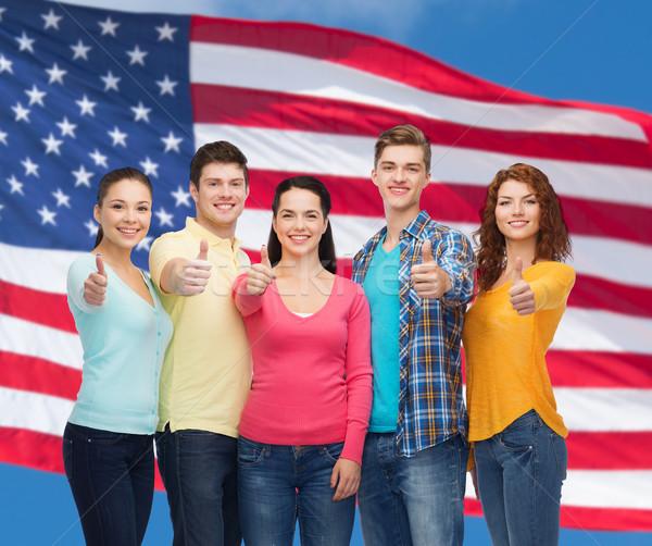 Grupo sonriendo adolescentes bandera de Estados Unidos amistad personas Foto stock © dolgachov