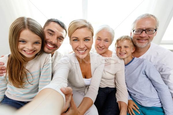 happy family making selfie at home Stock photo © dolgachov