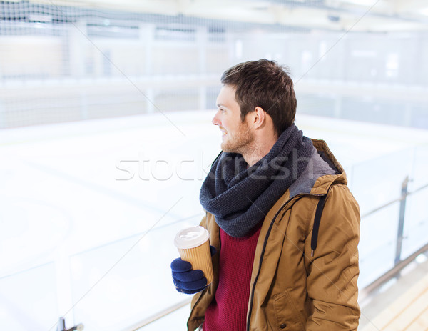 happy young man with coffee cup on skating rink Stock photo © dolgachov