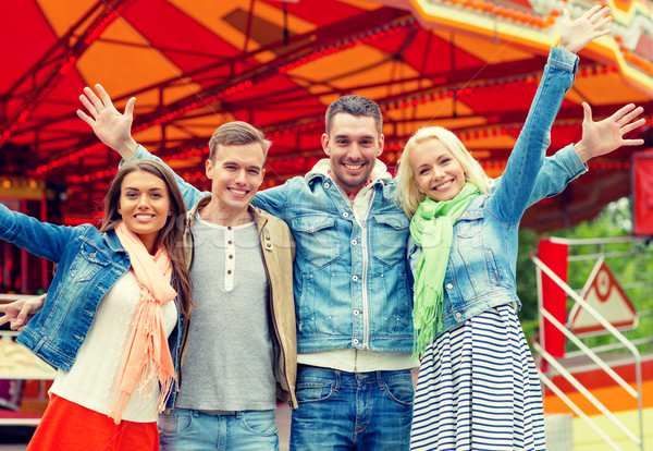 group of smiling friends waving hands Stock photo © dolgachov