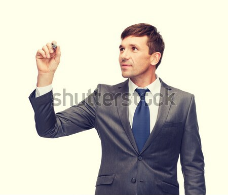 attractive buisnessman or teacher with marker Stock photo © dolgachov