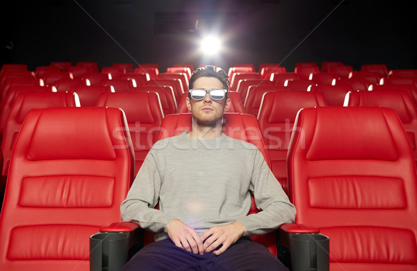 young man watching movie in 3d theater Stock photo © dolgachov