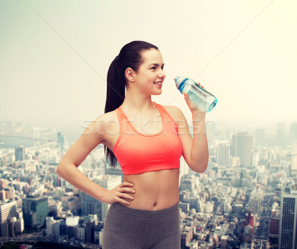 sporty woman with water bottle Stock photo © dolgachov