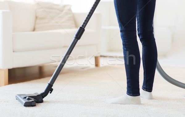 Donna gambe aspirapolvere home persone Foto d'archivio © dolgachov