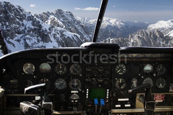 dashboard in airplane cockpit and mountains view Stock photo © dolgachov