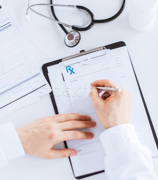 male doctor writing prescription paper Stock photo © dolgachov