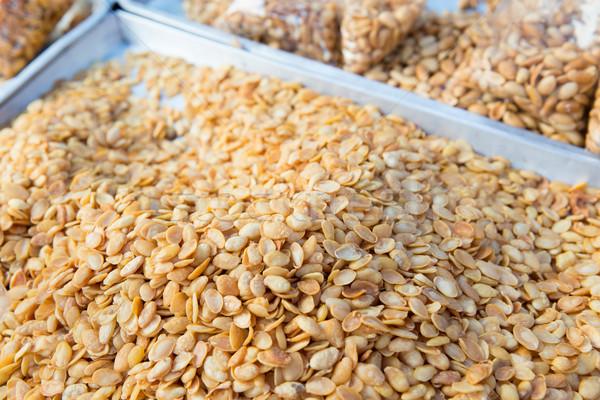 peanuts at asian street market Stock photo © dolgachov