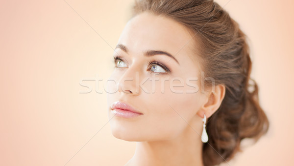 Stock photo: woman with diamond earrings